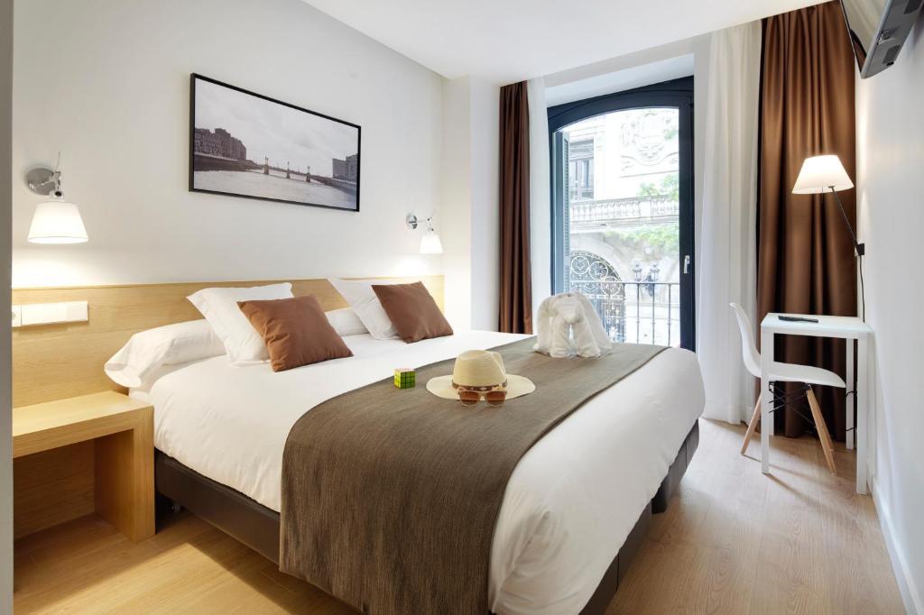 Llit o llits en una habitació de Pensión Garibai