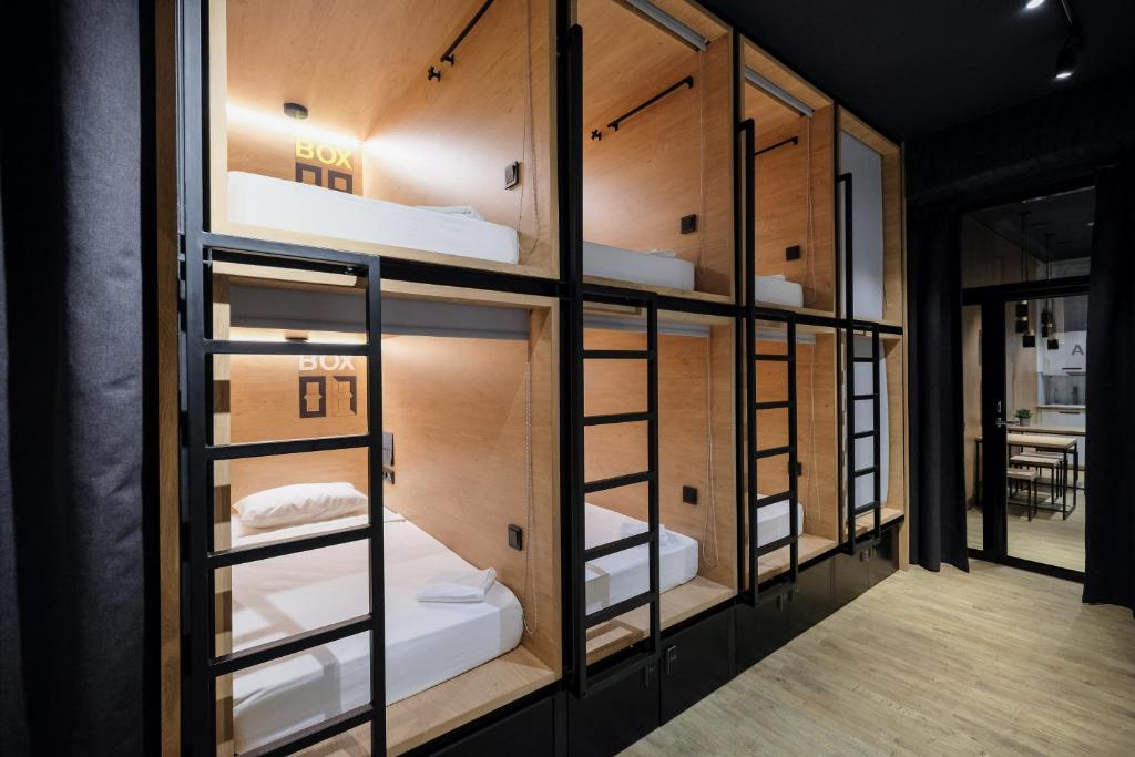 A bunk bed or bunk beds in a room at InBox Capsule Hotel