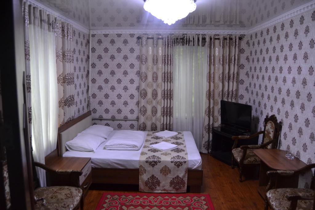 A bed or beds in a room at Friends guest house & Hostel