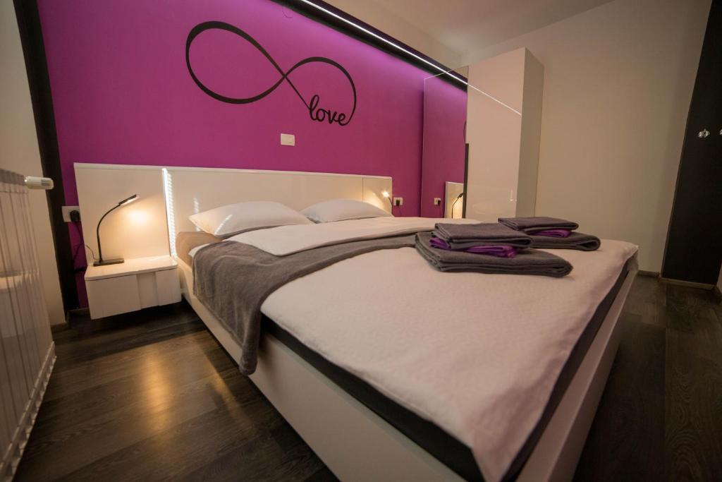 Un ou plusieurs lits dans un hébergement de l'établissement Apartment Andolsek