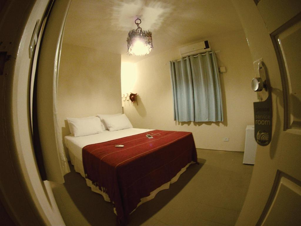 A bed or beds in a room at Pousada Vila Moana