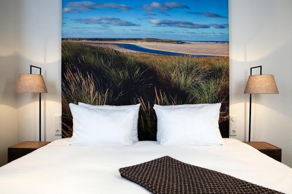 Een bed of bedden in een kamer bij Boutique Hotel De Smulpot