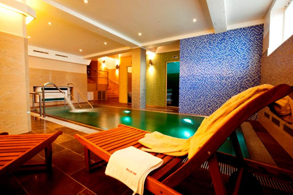 The swimming pool at or close to Relax Inn