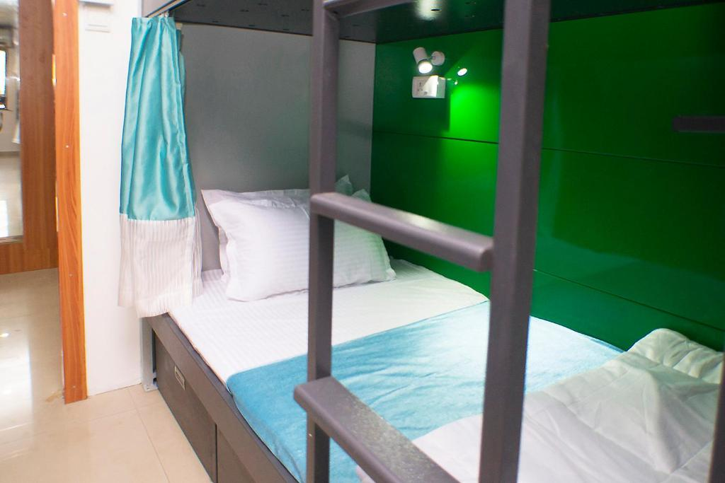 A bunk bed or bunk beds in a room at Arma Hostel Qubestay Mumbai