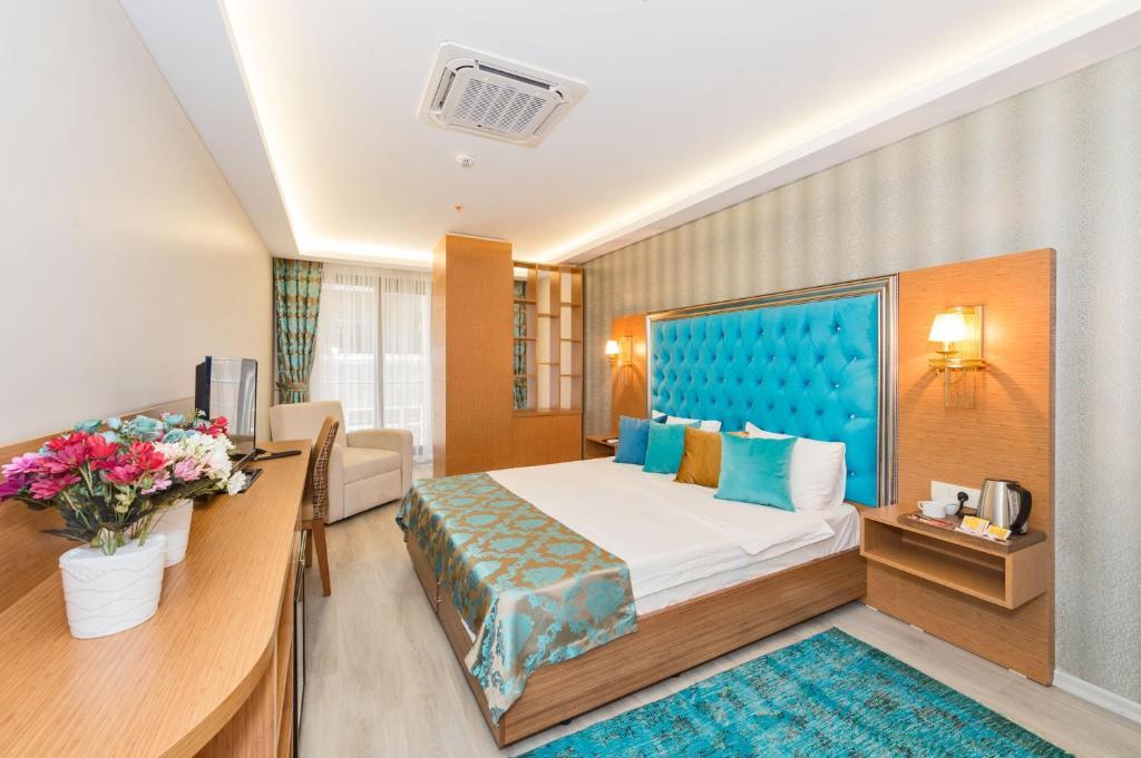 A room at Grand Palace Hotel