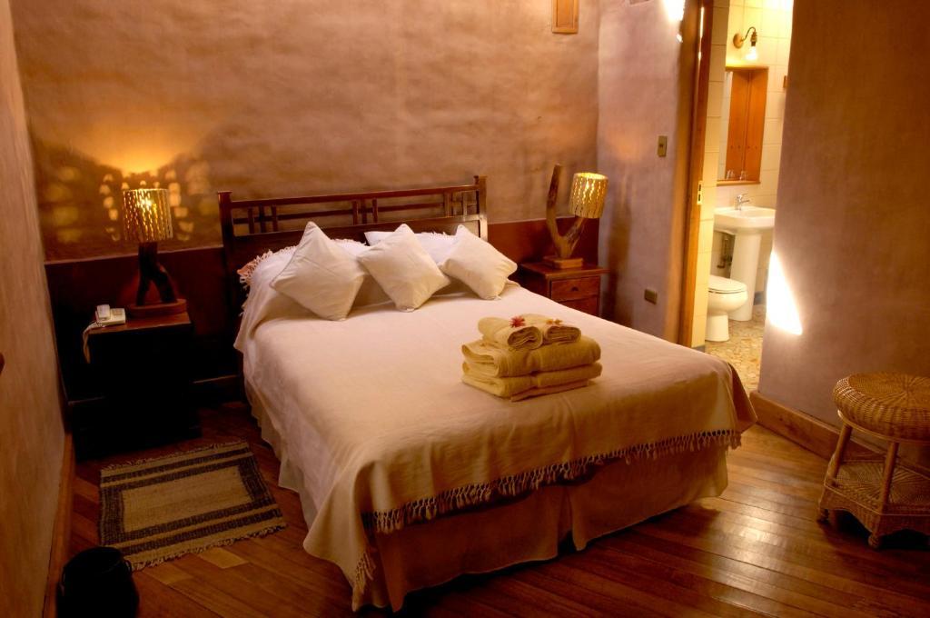 Um quarto em Hotel Kimal