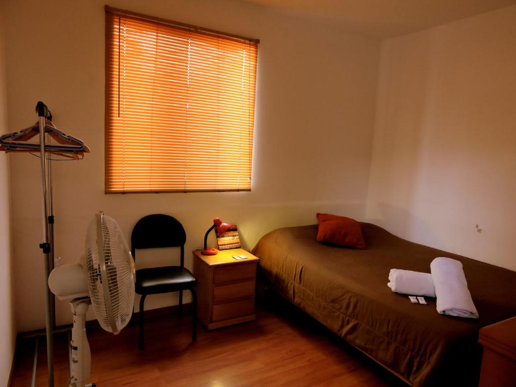A bed or beds in a room at La Casa de Karla