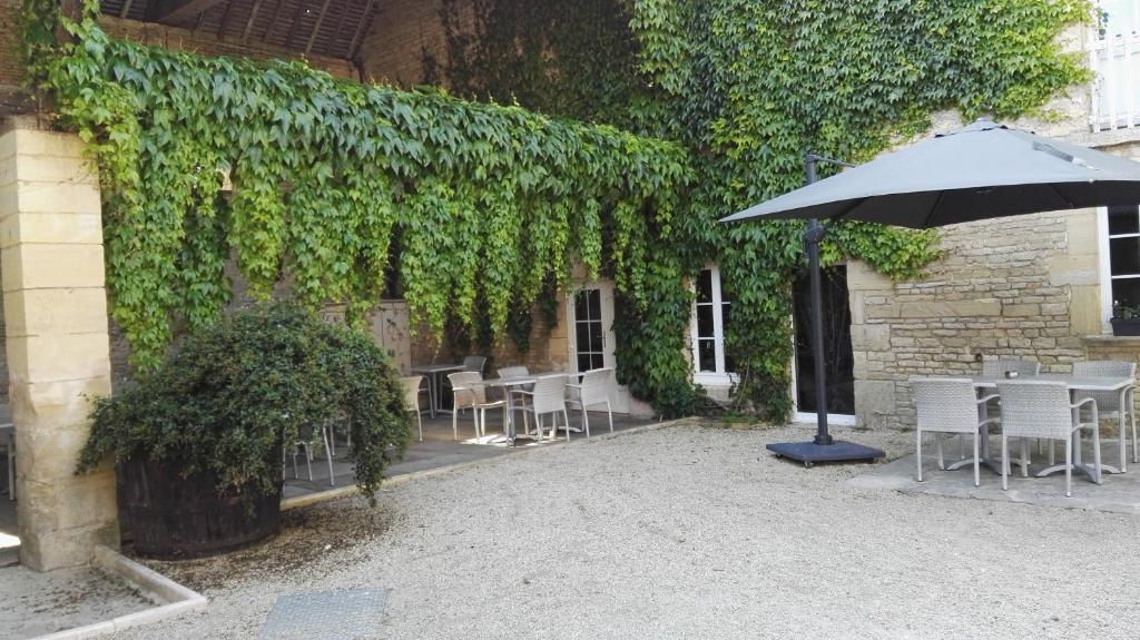 A porch or other outdoor area at Auberge De La Mue