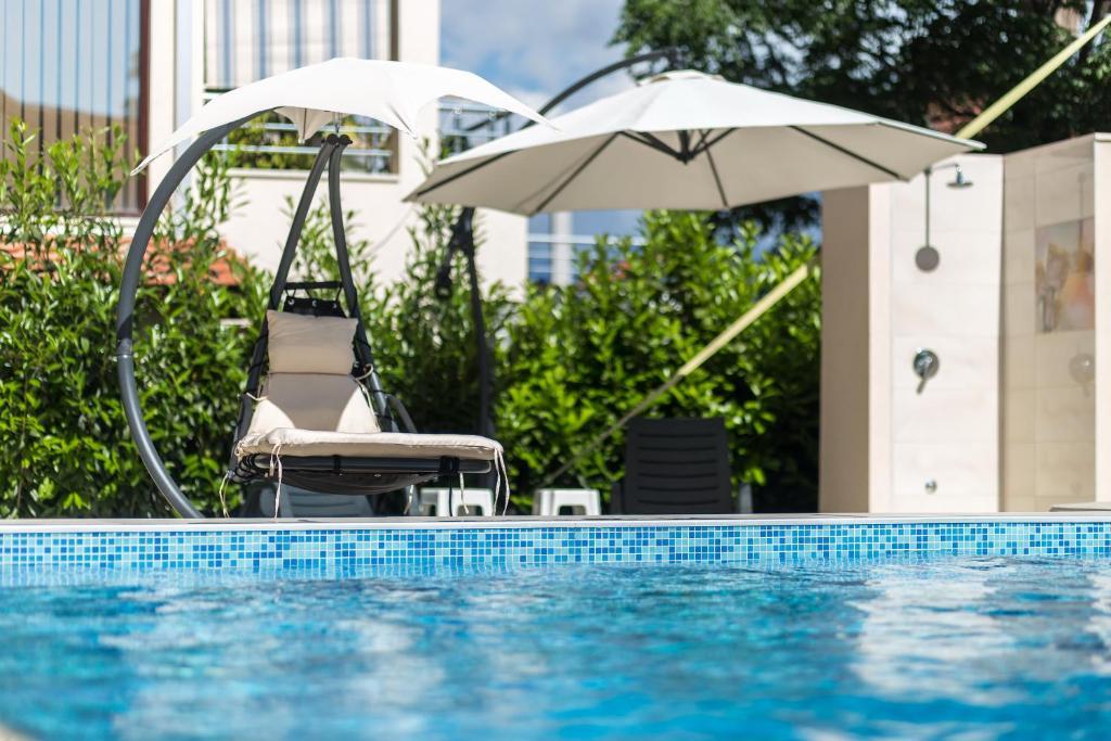 The swimming pool at or close to Apartments Rivijera