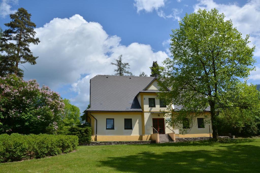 A garden outside Hostel Loučná nad Desnou