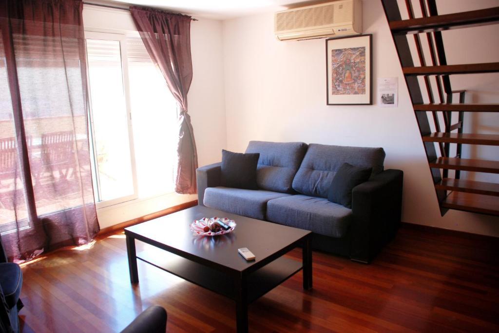 The lounge or bar area at Prado Apartamentos