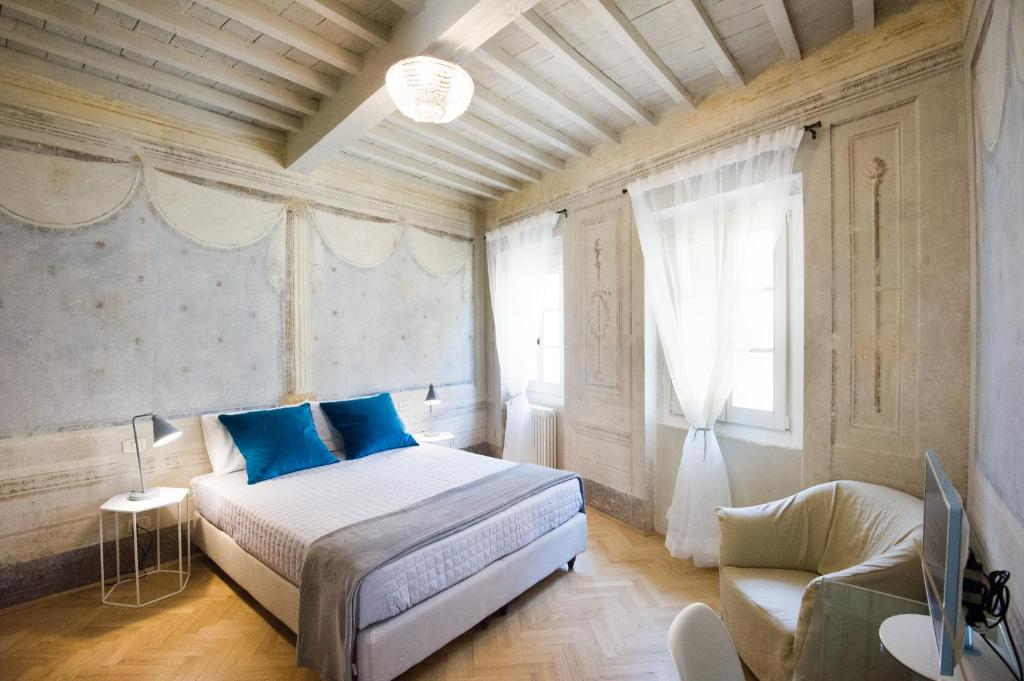 Llit o llits en una habitació de Il Piccolo Cavour Charming House