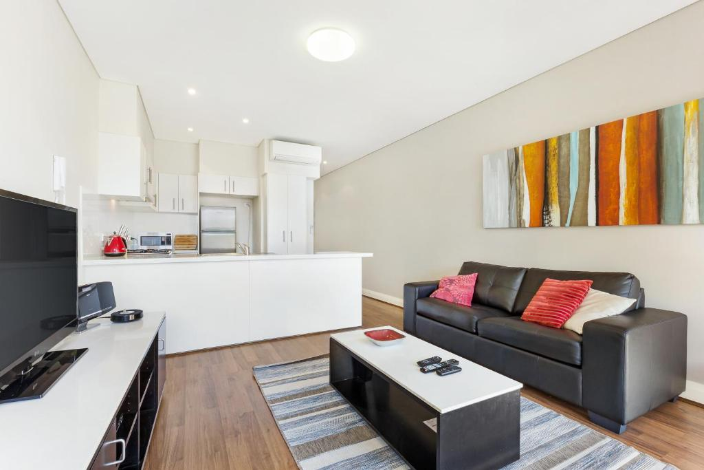 A seating area at Glebe Self-Contained Modern One-Bedroom Apartments