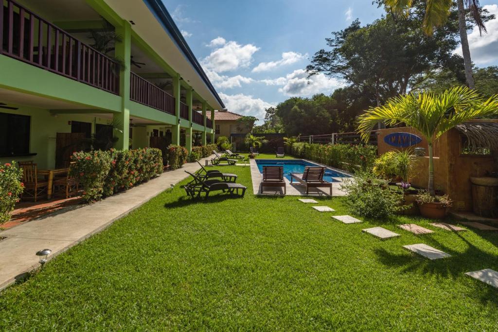 A garden outside Mavi Surf Hotel Dominical