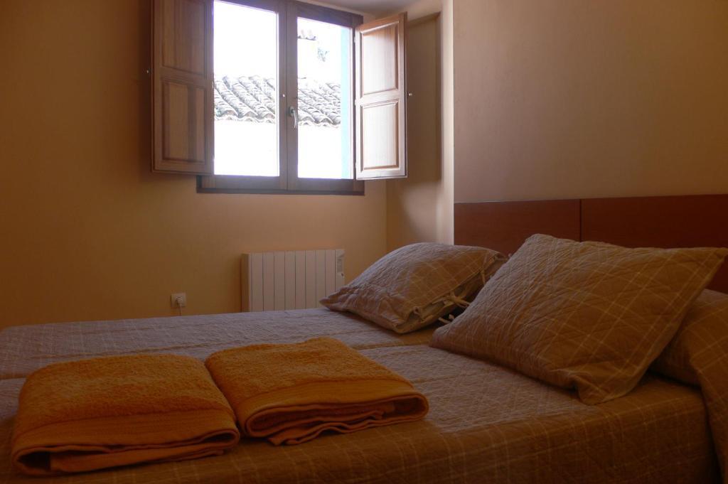 A bed or beds in a room at La Posada de Chóvar