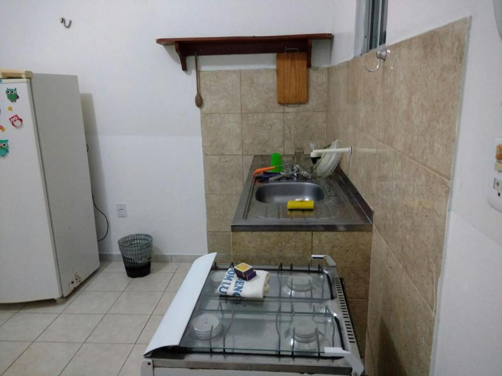 A kitchen or kitchenette at Residencial Dom Luiz