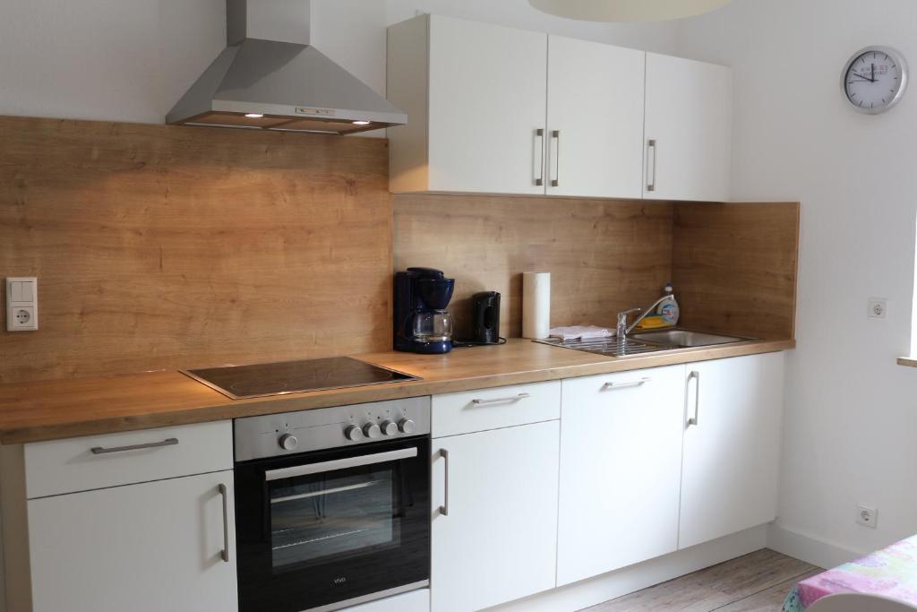 Küche/Küchenzeile in der Unterkunft Travel Apartments