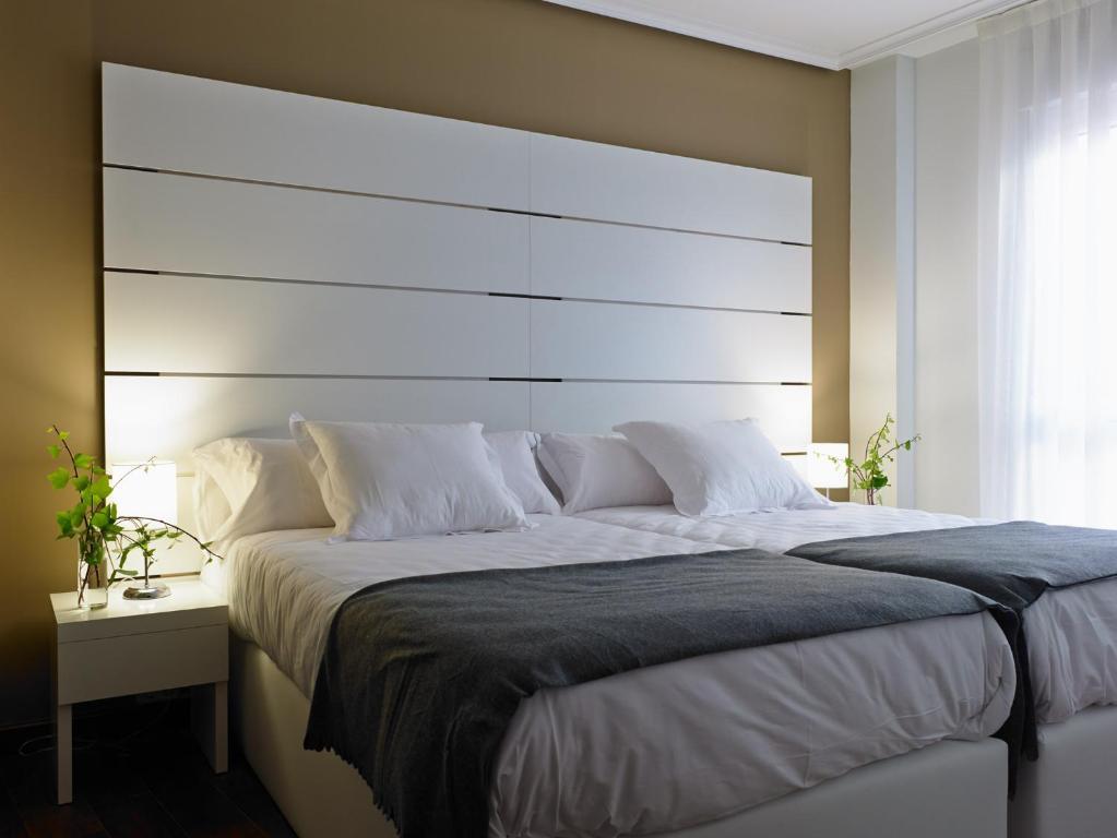 Et rom på Apartamentos Turísticos Taranco 5