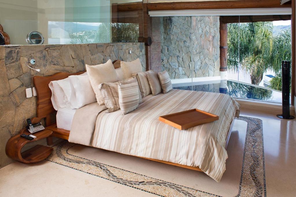 A bed or beds in a room at El Santuario Resort & Spa