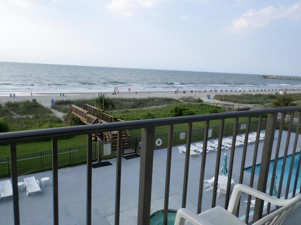 A balcony or terrace at Tropical Seas Hotel