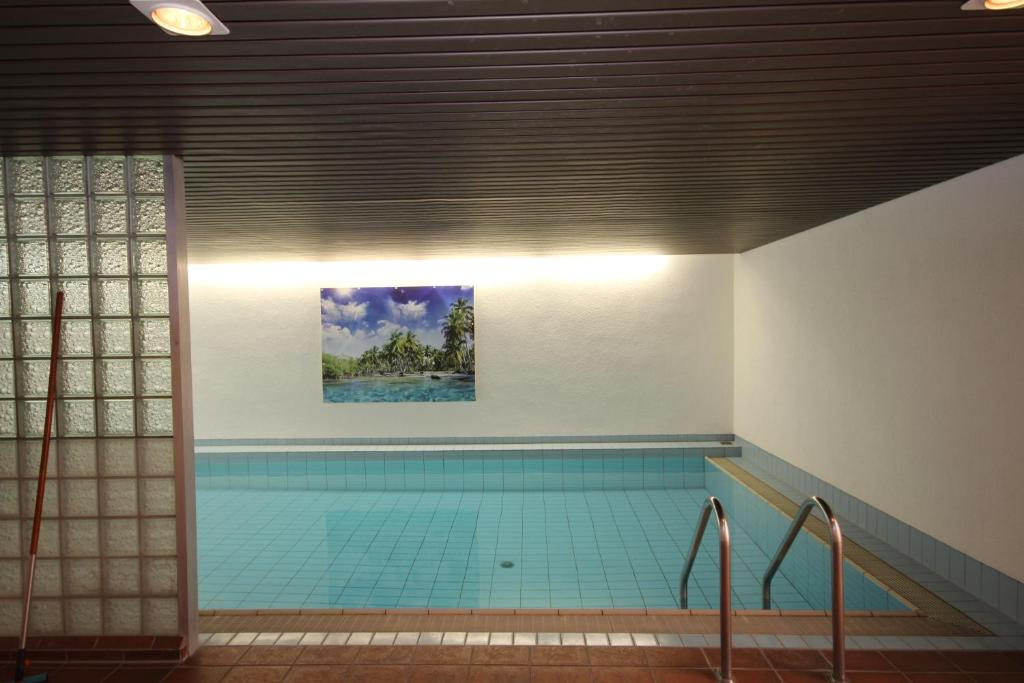 The swimming pool at or near Hotel Restaurant Zum Jägerheim