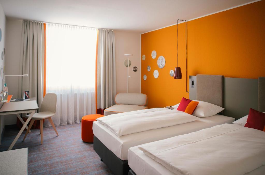 Ein Zimmer in der Unterkunft Vienna House Easy Neckarsulm