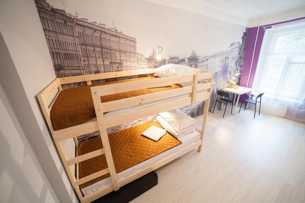 A bunk bed or bunk beds in a room at Drive Hostel