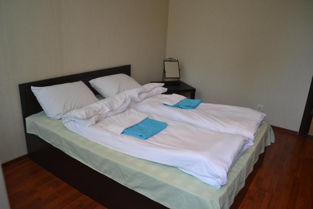 Кровать или кровати в номере Хостел Удача