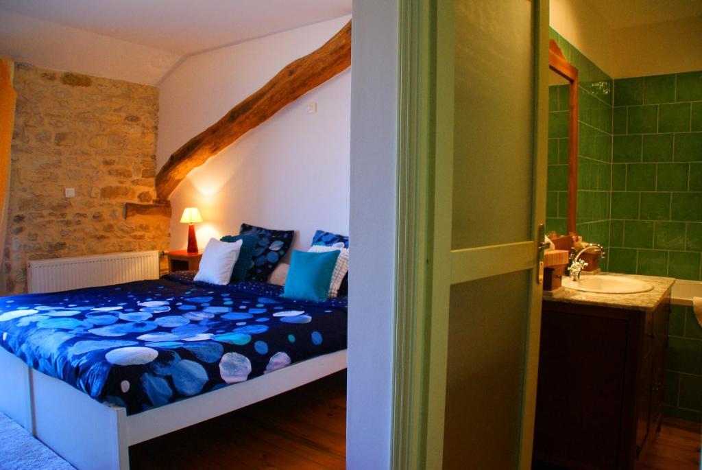 Ein Bett oder Betten in einem Zimmer der Unterkunft Chez Catharina Oldtimer B&B