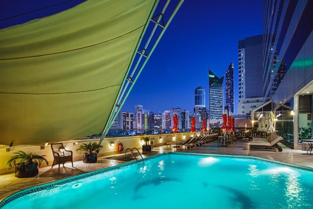 The swimming pool at or near Corniche Hotel Abu Dhabi