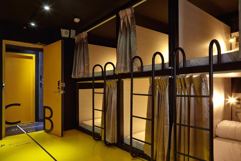 A bunk bed or bunk beds in a room at Here x There Hostel Taipei Main Station