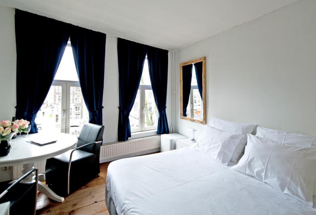 Un ou plusieurs lits dans un hébergement de l'établissement Canal guesthouse since 1657