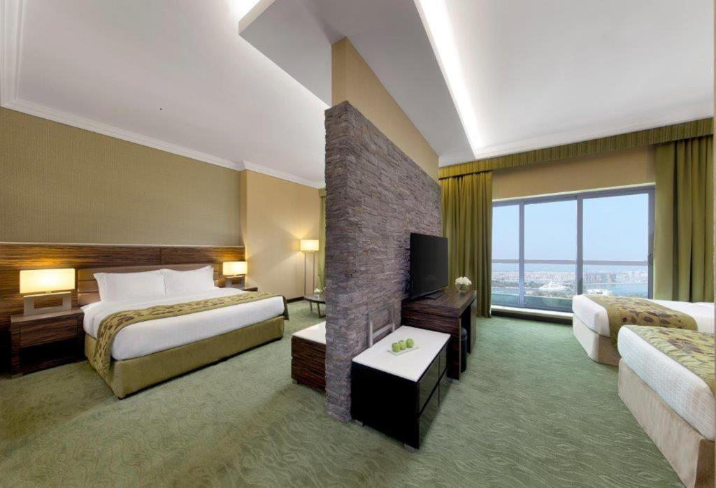 A bed or beds in a room at Atana Hotel