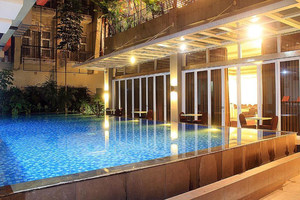 The swimming pool at or near ZEN Premium Setrawangi Raya