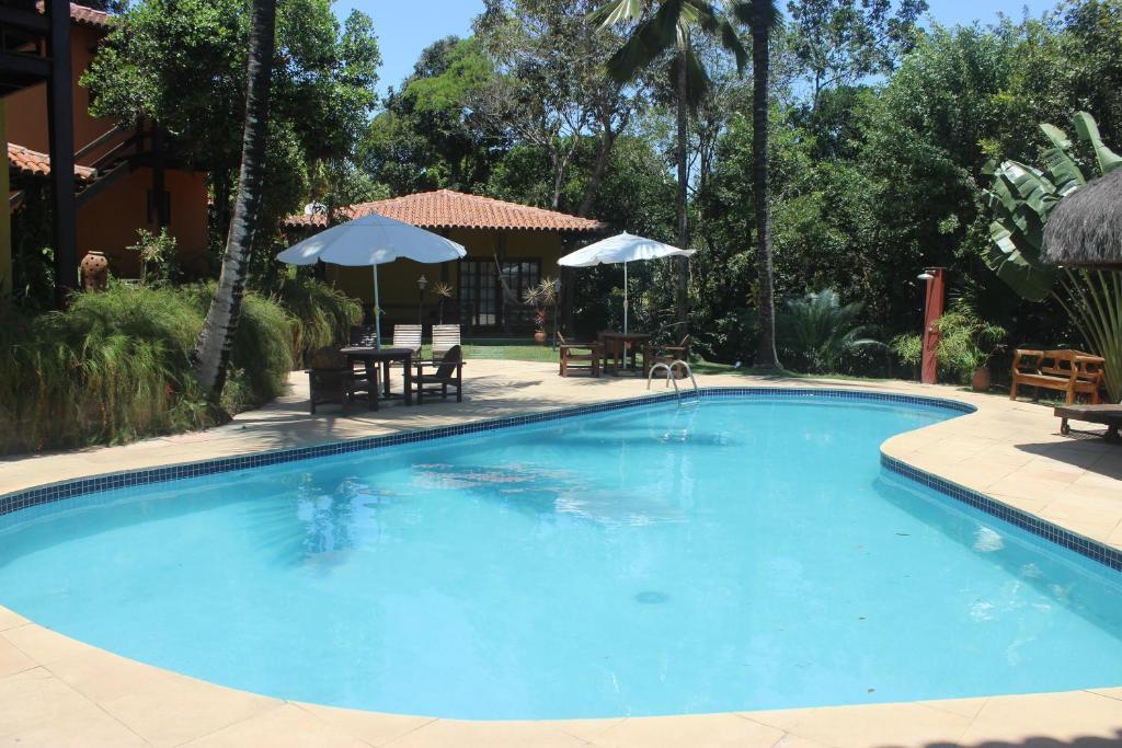 The swimming pool at or near Pousada Catamara