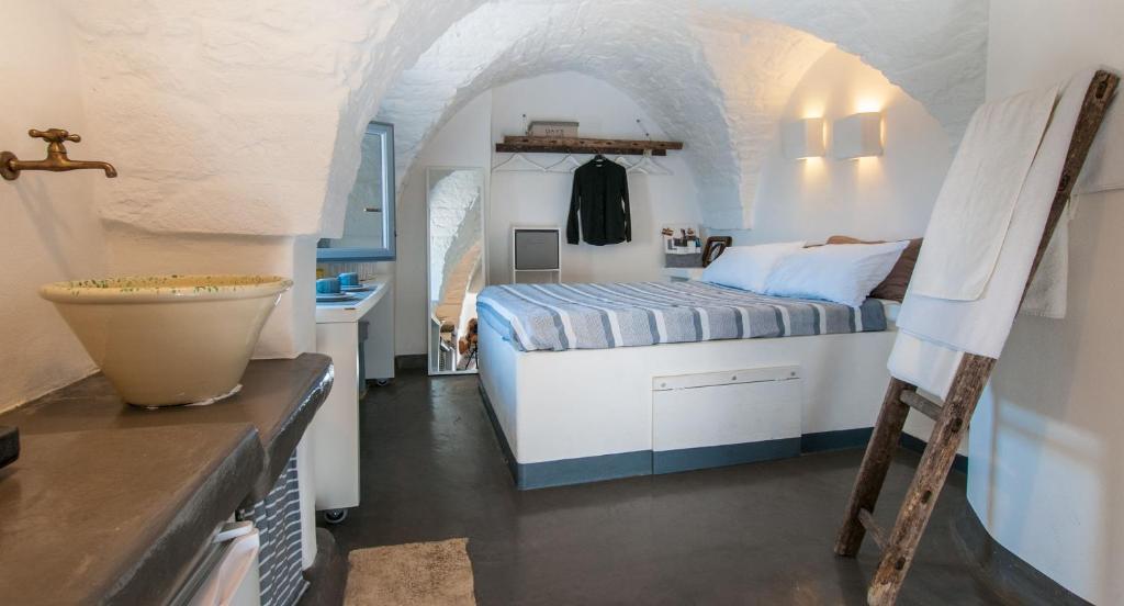 Ein Bett oder Betten in einem Zimmer der Unterkunft I 7 Archi Guest House