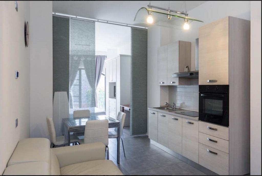 A kitchen or kitchenette at Casa Adriana