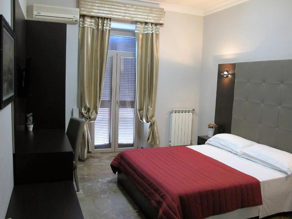 A bed or beds in a room at Hotel d'Este