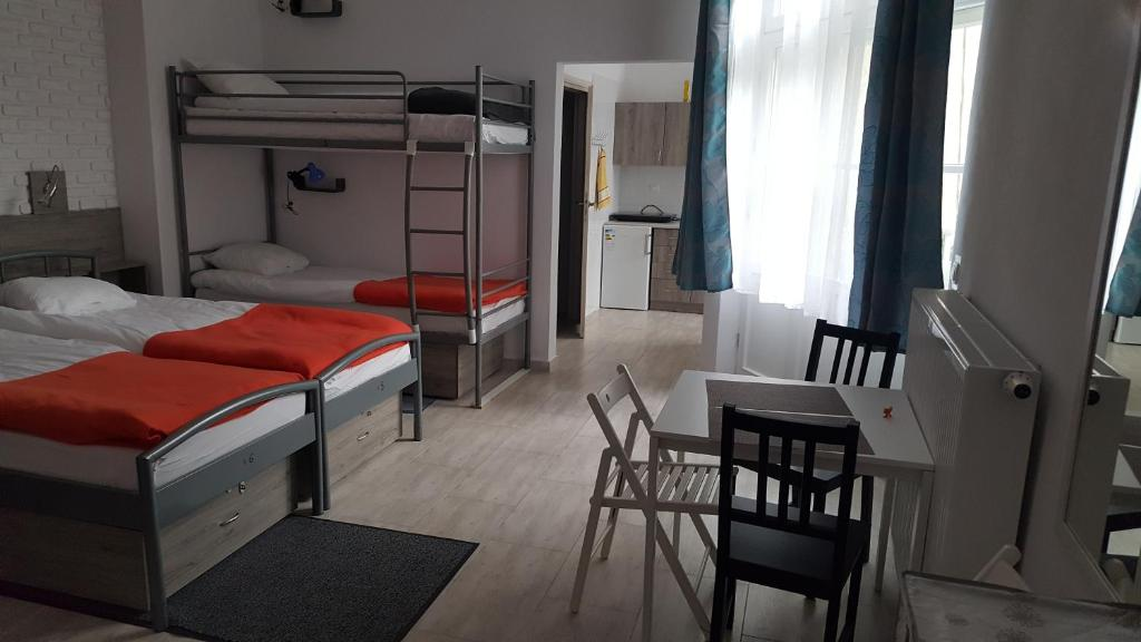 A bunk bed or bunk beds in a room at Hostel Lwowska 11