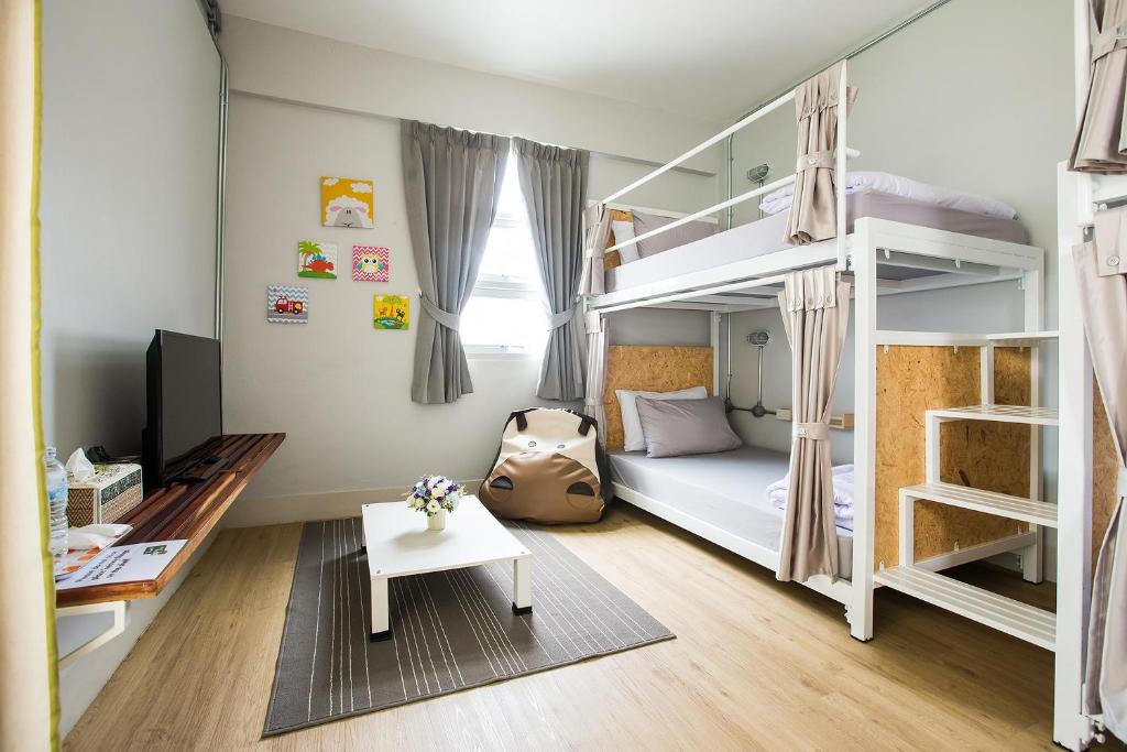 A bunk bed or bunk beds in a room at Cubic Bangkok