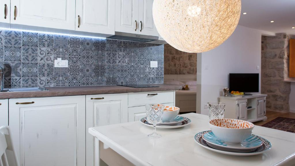 A kitchen or kitchenette at Dubrovnik Homes