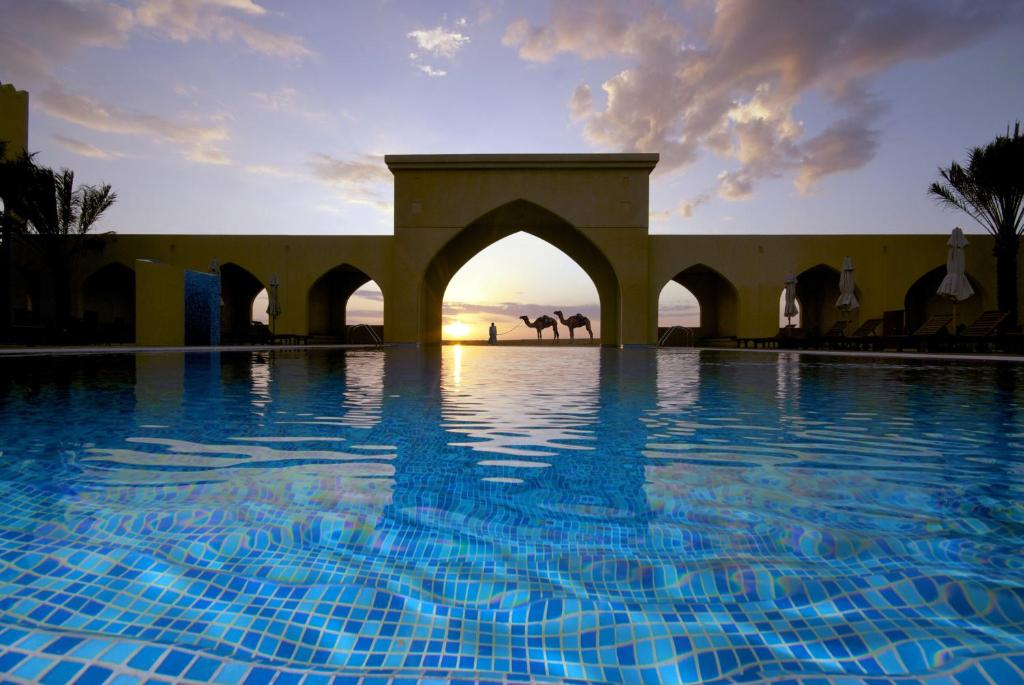 The swimming pool at or near Tilal Liwa Hotel - Madinat Zayed