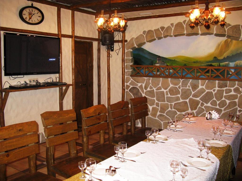 A restaurant or other place to eat at Lesnaya Polyana
