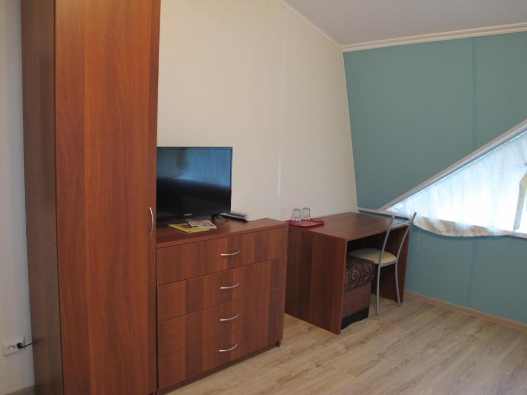 A television and/or entertainment center at Lida Mini-hotel