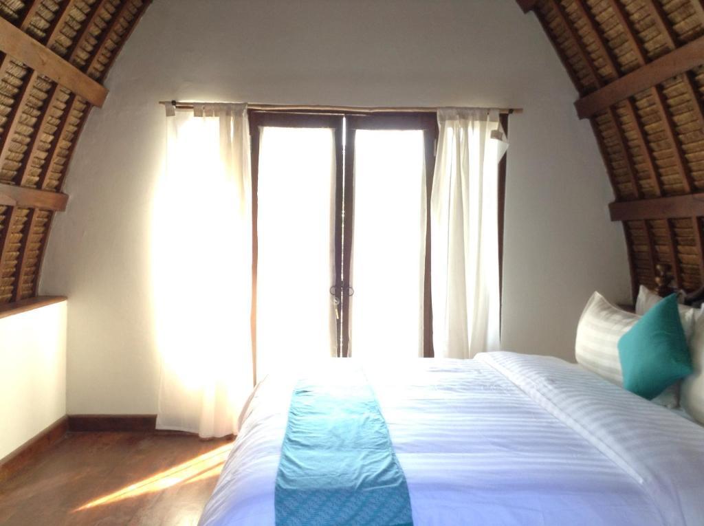Tempat tidur dalam kamar di Karimun Lumbung