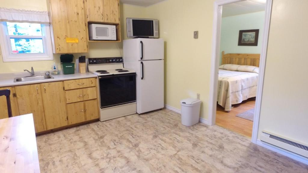 A kitchen or kitchenette at Forest & Stream Cottages