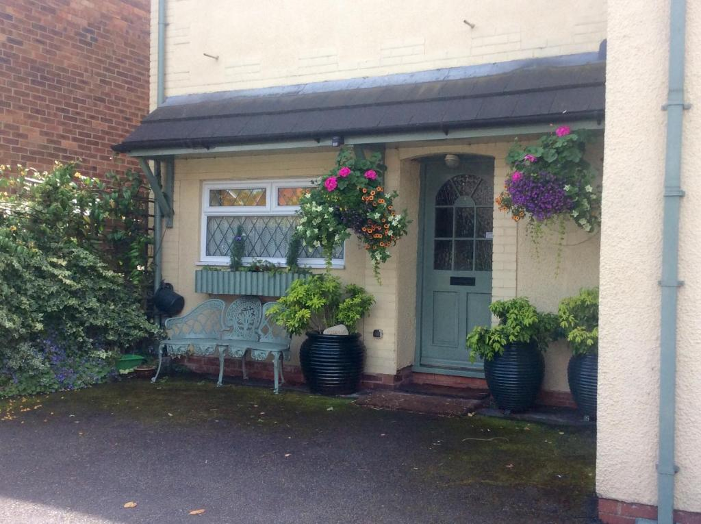 A porch or other outdoor area at Mere Cottage B & B