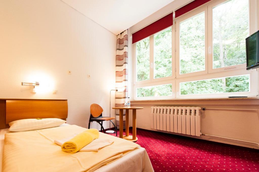 Ein Zimmer in der Unterkunft B&B Seminar Hotel in der Akademie