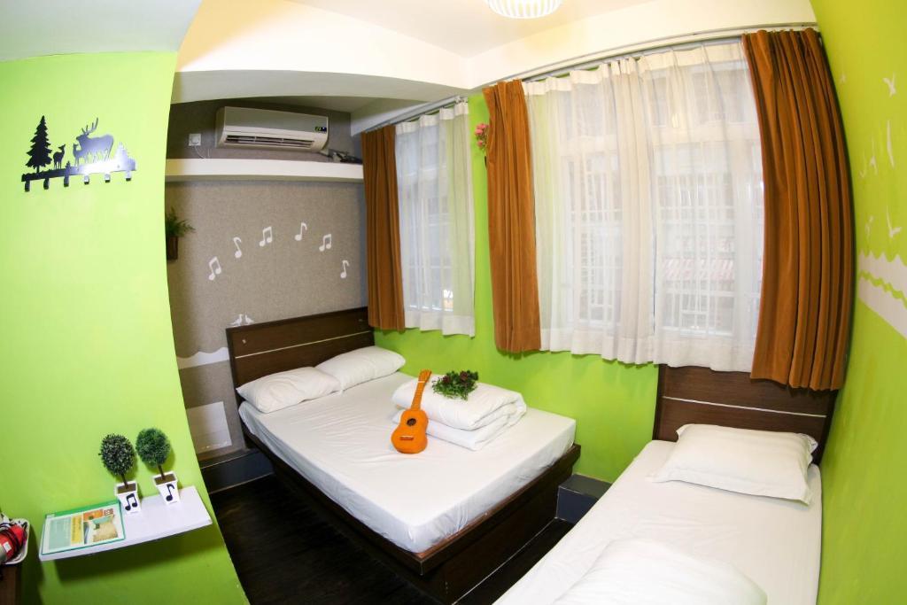 A room at Tempo Inn@ David Mansion