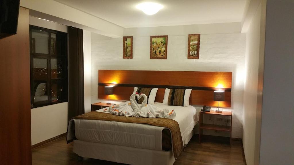 Cama o camas de una habitación en Balconcillo Hotel Boutique